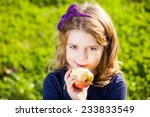 happy kid eating fruits from... | Shutterstock . vector #233833549