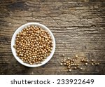 bowl of coriander seeds on old... | Shutterstock . vector #233922649