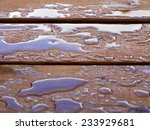 Droplets Of Water On A Wooden...