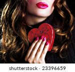 Vatentine's: woman and red heart - stock photo