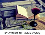 open book with wine glass on a... | Shutterstock . vector #233969209