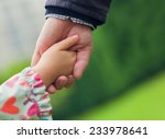 father and daughter holding... | Shutterstock . vector #233978641