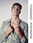 handsome bare chested young man  | Shutterstock . vector #234032311