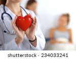 young woman doctor holding a... | Shutterstock . vector #234033241