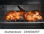 piece of baked chicken in oven... | Shutterstock . vector #234036457