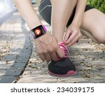 human hand tying shoelaces... | Shutterstock . vector #234039175