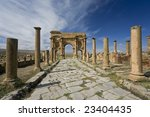 Algeria. Timgad (ancient Thamugadi or Thamugas). Decumanus street and surrounding colonnade terminated Trajan