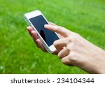 close up of woman using mobile... | Shutterstock . vector #234104344