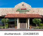 Small photo of NORTHRIDGE, CA/USA - NOVEMBER 24, 2014: Romano's Macaroni Grill exterior. Romano's Macaroni Grill is a casual dining restaurant chain specializing in Italian-American cuisine.