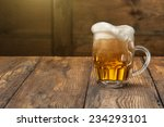 light beer in mug on wooden... | Shutterstock . vector #234293101