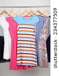 female dresses on hangers in... | Shutterstock . vector #234377509