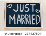 wedding car with just married... | Shutterstock . vector #234427504