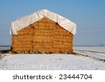 Agriculture haystack in a winter landscape - stock photo