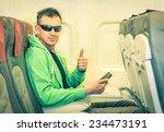 young hipster man passenger... | Shutterstock . vector #234473191