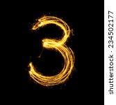Sparkler firework light alphabet number 3 isolated on black background.