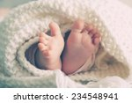 photo of newborn baby feet | Shutterstock . vector #234548941
