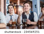 four men fans drinking beer and ... | Shutterstock . vector #234569251