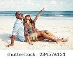 loving couple relaxing on sandy ... | Shutterstock . vector #234576121