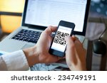 smart phone with qr code on the ... | Shutterstock . vector #234749191