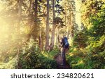 man backpacker in forest - stock photo