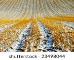 Harvested agriculture field in winter - stock photo