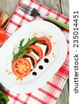 eggplant salad with tomatoes... | Shutterstock . vector #235014451