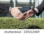handshake of businessman to... | Shutterstock . vector #235212469
