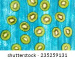 kiwi slices on blue wood... | Shutterstock . vector #235259131