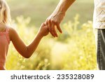 a parent holds the hand of a... | Shutterstock . vector #235328089
