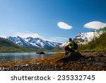 sportsman  sitting on lakeside... | Shutterstock . vector #235332745