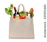 Small photo of Reusable shopping bag full of groceries isolated on white background / clipping path