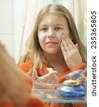 girl with bathrobe putting... | Shutterstock . vector #235365805