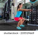 air squat woman workout... | Shutterstock . vector #235519669