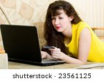 Woman with a notebook - online shopping - stock photo
