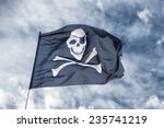 Waving pirate flag jolly roger...