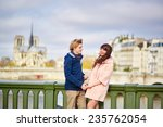happy dating couple walking in... | Shutterstock . vector #235762054