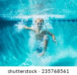 underwater young boy fun in the ... | Shutterstock . vector #235768561