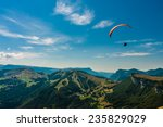 Paraglider Flies Over The...