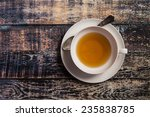 Stock photo closeup of cup of tea on vintage wooden background 235838785