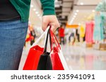 woman holding shopping bag in