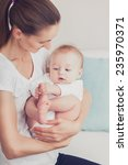 newborn baby with his young... | Shutterstock . vector #235970371