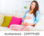 Pregnant Happy Smiling Woman...