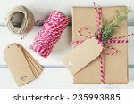 a paper parcel with a pine... | Shutterstock . vector #235993885