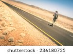 lonely man walking along the... | Shutterstock . vector #236180725