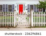 Red Door And A White Picket...