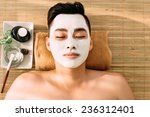 man relaxing with facial mask... | Shutterstock . vector #236312401