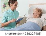 young beautiful nurse reading