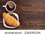coffee cup with croissant for... | Shutterstock . vector #236390134