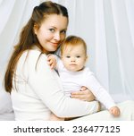 portrait happy mother and baby... | Shutterstock . vector #236477125