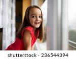beautiful little girl smiling... | Shutterstock . vector #236544394